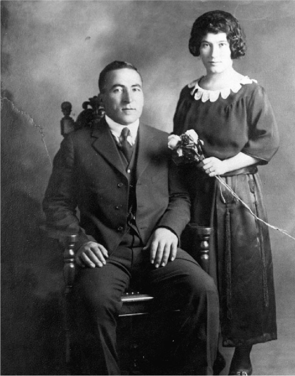 black and white picture of a man and a woman looking at the camera